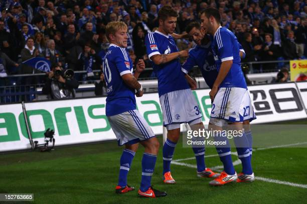 Lewis Holtby celebrates the second goal with Roman Neustaedter Tranquillo Barnetta and Marco Hoeger of Schalke during the Bundesliga match between FC...