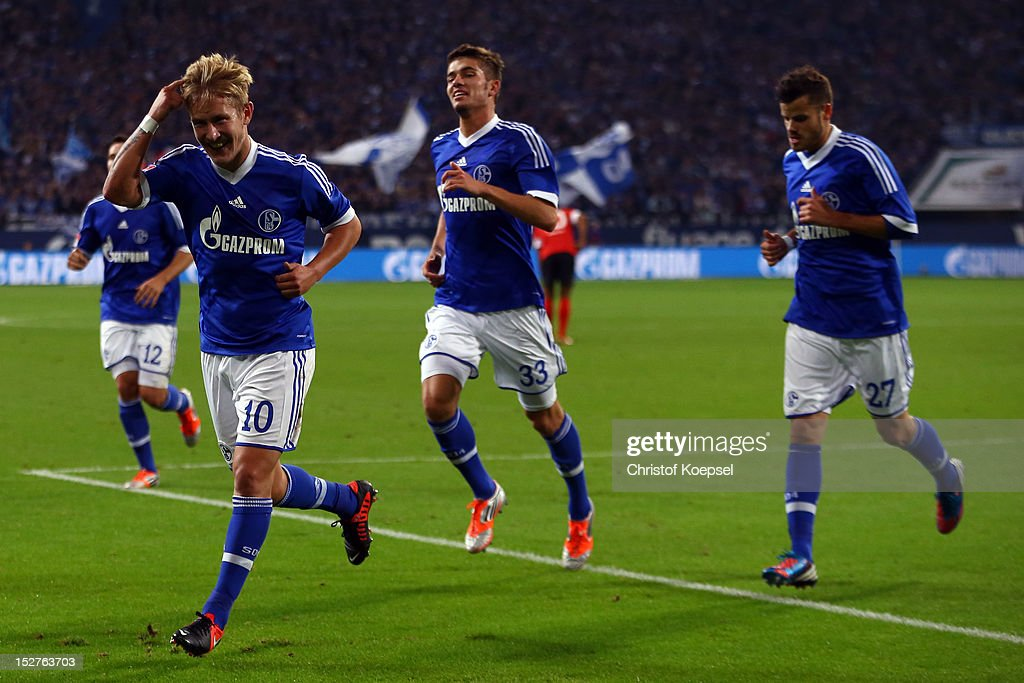 <a gi-track='captionPersonalityLinkClicked' href=/galleries/search?phrase=Lewis+Holtby&family=editorial&specificpeople=5351202 ng-click='$event.stopPropagation()'>Lewis Holtby</a> celebrates the second goal with <a gi-track='captionPersonalityLinkClicked' href=/galleries/search?phrase=Roman+Neustaedter&family=editorial&specificpeople=5437402 ng-click='$event.stopPropagation()'>Roman Neustaedter</a> and <a gi-track='captionPersonalityLinkClicked' href=/galleries/search?phrase=Tranquillo+Barnetta&family=editorial&specificpeople=534444 ng-click='$event.stopPropagation()'>Tranquillo Barnetta</a> of Schalke during the Bundesliga match between FC Schalke 04 and FSV Mainz at Veltins-Arena on September 25, 2012 in Gelsenkirchen, Germany.