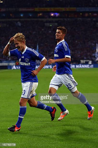 Lewis Holtby celebrates the second goal with Roman Neustaedter of Schalke during the Bundesliga match between FC Schalke 04 and FSV Mainz at...