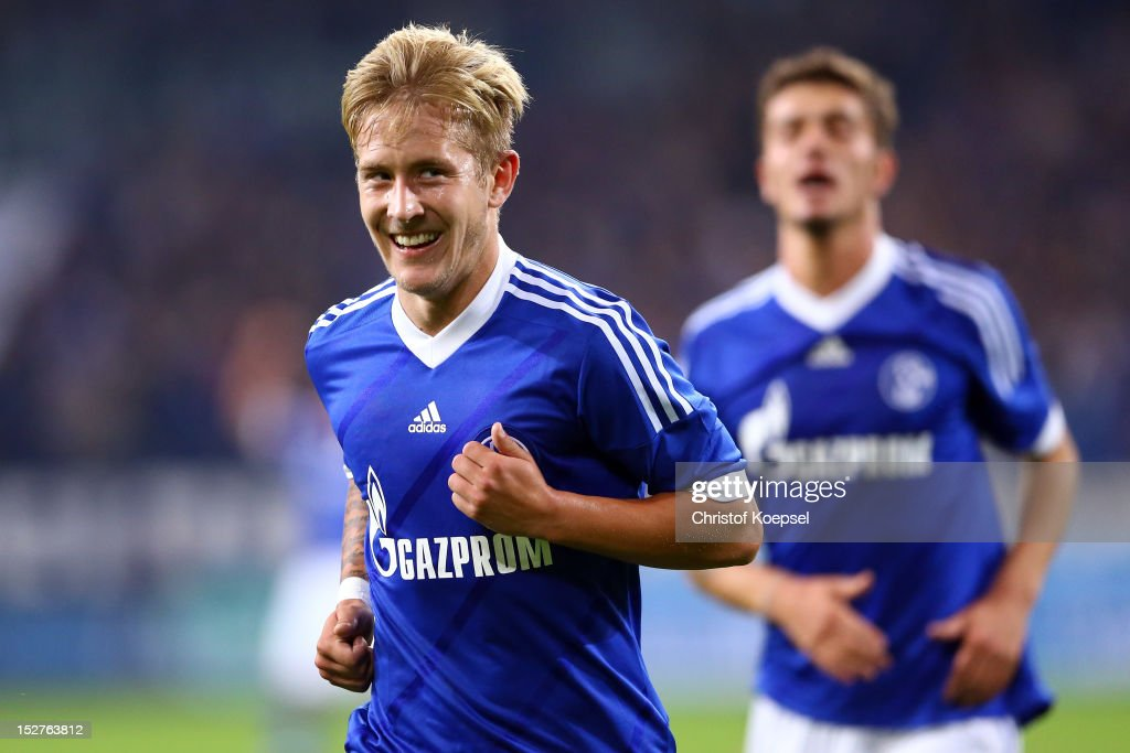 <a gi-track='captionPersonalityLinkClicked' href=/galleries/search?phrase=Lewis+Holtby&family=editorial&specificpeople=5351202 ng-click='$event.stopPropagation()'>Lewis Holtby</a> celebrates the second goal with Roman Neustaedter of Schalke during the Bundesliga match between FC Schalke 04 and FSV Mainz at Veltins-Arena on September 25, 2012 in Gelsenkirchen, Germany.