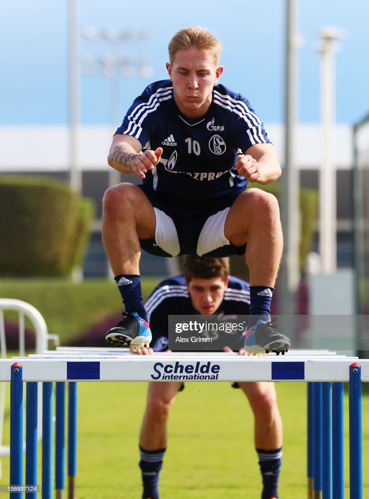 <a gi-track='captionPersonalityLinkClicked' href=/galleries/search?phrase=Lewis+Holtby&family=editorial&specificpeople=5351202 ng-click='$event.stopPropagation()'>Lewis Holtby</a> exercises during a Schalke 04 training session at the ASPIRE Academy for Sports Excellenc on January 4, 2013 in Doha, Qatar.