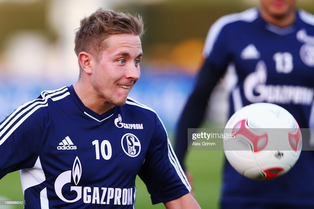 <a gi-track='captionPersonalityLinkClicked' href=/galleries/search?phrase=Lewis+Holtby&family=editorial&specificpeople=5351202 ng-click='$event.stopPropagation()'>Lewis Holtby</a> focusses on the ball during a Schalke 04 training session at the ASPIRE Academy for Sports Excellence on January 5, 2013 in Doha, Qatar.