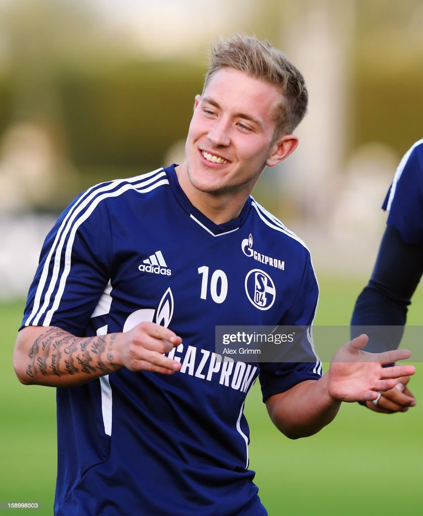 <a gi-track='captionPersonalityLinkClicked' href=/galleries/search?phrase=Lewis+Holtby&family=editorial&specificpeople=5351202 ng-click='$event.stopPropagation()'>Lewis Holtby</a> gestures during a Schalke 04 training session at the ASPIRE Academy for Sports Excellence on January 5, 2013 in Doha, Qatar.