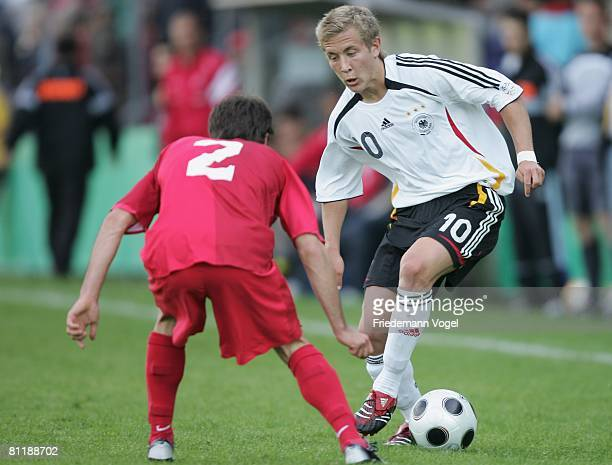 Lewis Holtby of Germany battles for the ball with Erhan Karayer of Turkey during the Men's U18 international friendly match between Germany and...