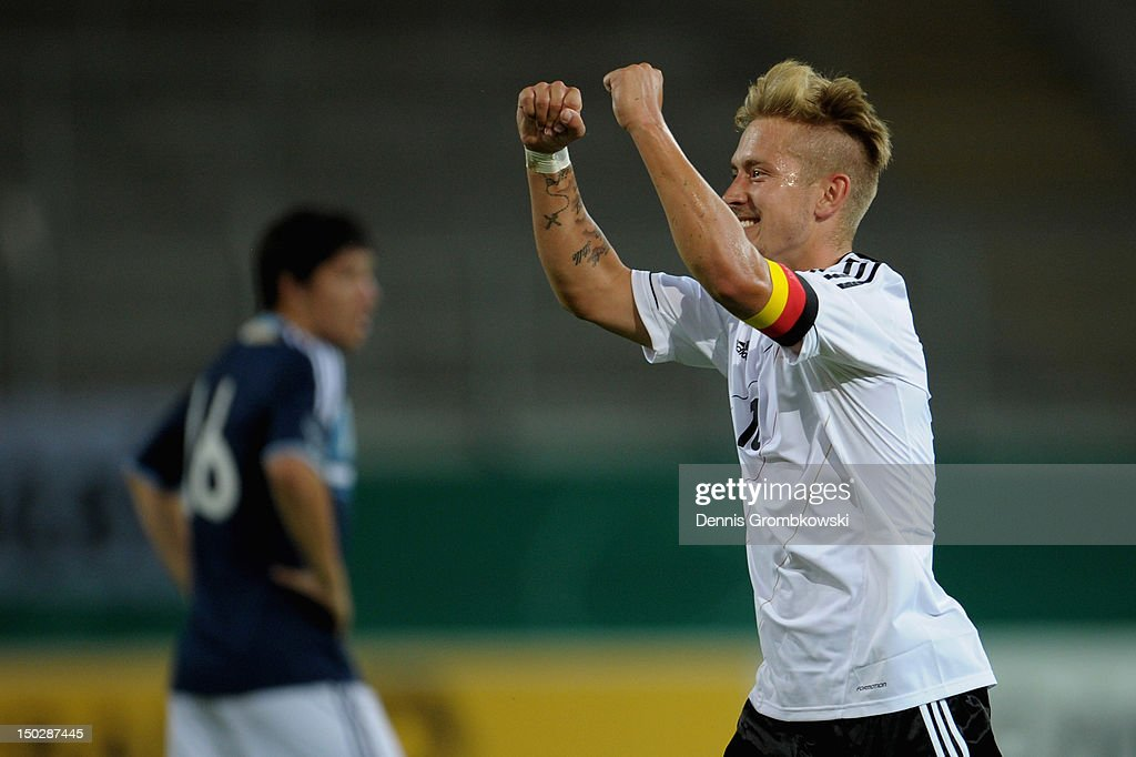 <a gi-track='captionPersonalityLinkClicked' href=/galleries/search?phrase=Lewis+Holtby&family=editorial&specificpeople=5351202 ng-click='$event.stopPropagation()'>Lewis Holtby</a> of Germany celebrates after scoring his team's fourth goal during the Under 21 international friendly match between Germany U21 and Argentina U21 at Sparda-Bank-Hessen-Stadion on August 14, 2012 in Offenbach, Germany.