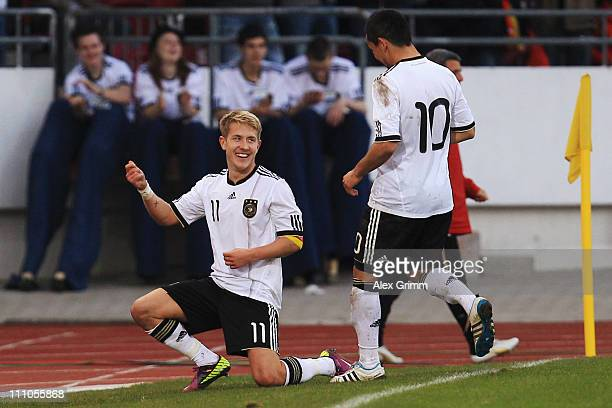 Lewis Holtby of Germany celebrates his team's second goal with team mate Ilkay Guendogan during the U21 international friendly match between Germany...