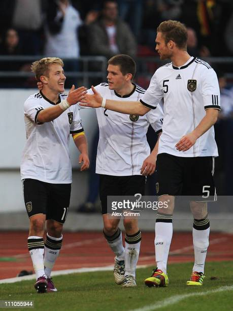 Lewis Holtby of Germany celebrates his team's second goal with team mates Sebastian Jung and Jan Kirchhoff during the U21 international friendly...