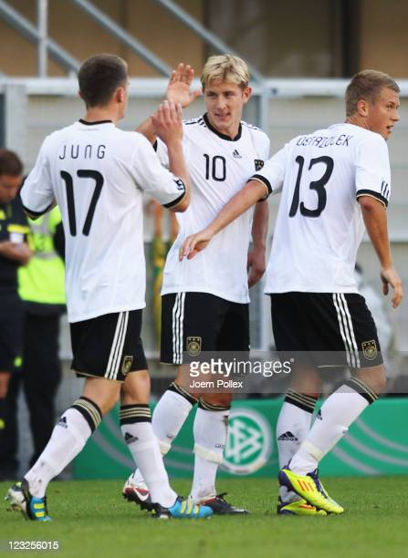 Lewis Holtby of Germany celebrates with his team mates after scoring his team's second goal during the 2013 UEFA European Under21 Qualifier Group 1...