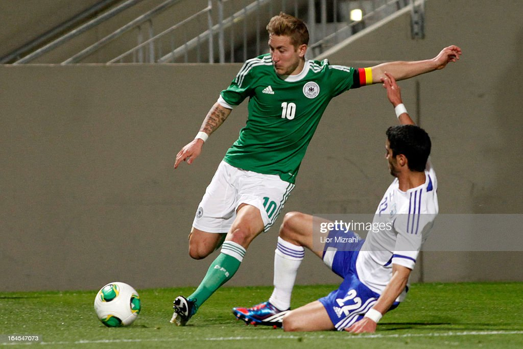 <a gi-track='captionPersonalityLinkClicked' href=/galleries/search?phrase=Lewis+Holtby&family=editorial&specificpeople=5351202 ng-click='$event.stopPropagation()'>Lewis Holtby</a> of Germany challenges Ofir Krief of Israel during the Under 21 International Friendly match between Israel and Germany on March 24 2013 in Tel Aviv , Israel.