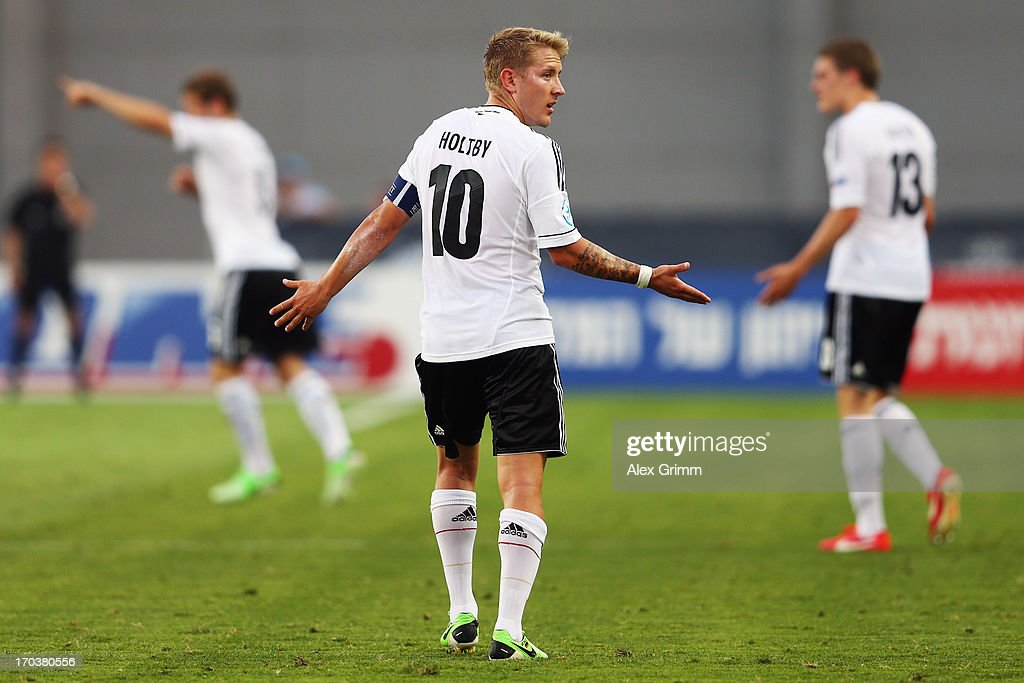 <a gi-track='captionPersonalityLinkClicked' href=/galleries/search?phrase=Lewis+Holtby&family=editorial&specificpeople=5351202 ng-click='$event.stopPropagation()'>Lewis Holtby</a> of Germany reacts during the UEFA European U21 Championship Group B match between Russia and Germany at Netanya Stadium on June 12, 2013 in Netanya, Israel.