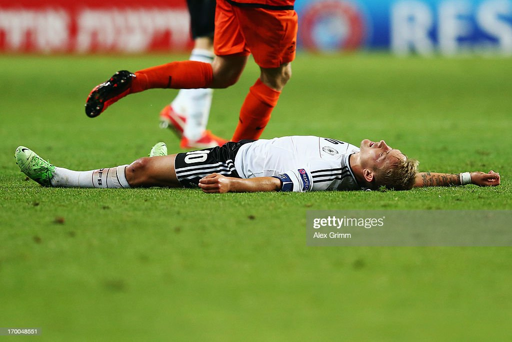 <a gi-track='captionPersonalityLinkClicked' href=/galleries/search?phrase=Lewis+Holtby&family=editorial&specificpeople=5351202 ng-click='$event.stopPropagation()'>Lewis Holtby</a> of Germany reacts during the UEFA European Under 21 Championship match between Netherlands and Germany at Ha Moshava Stadium on June 6, 2013 in Petah Tiqwa, Israel.