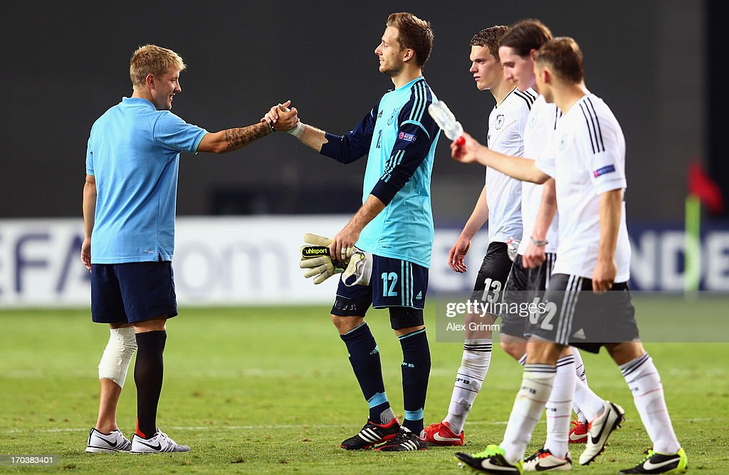 <a gi-track='captionPersonalityLinkClicked' href=/galleries/search?phrase=Lewis+Holtby&family=editorial&specificpeople=5351202 ng-click='$event.stopPropagation()'>Lewis Holtby</a> (L) of Germany shakes hands with goalkeeper Oliver Baumann of Germany during the UEFA European U21 Championship Group B match between Russia and Germany at Netanya Stadium on June 12, 2013 in Netanya, Israel.