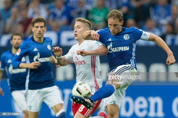 Lewis Holtby of Hamburg and Benedikt Hoewedes of Schalke battle for the ball during to the Bundesliga match between FC Schalke 04 and Hamburger SV at...
