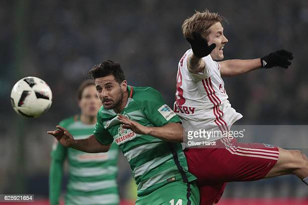 Lewis Holtby of Hamburg and Claudio Pizarro of Bremen compete for the ball during the Bundesliga match between Hamburger SV and Werder Bremen at...