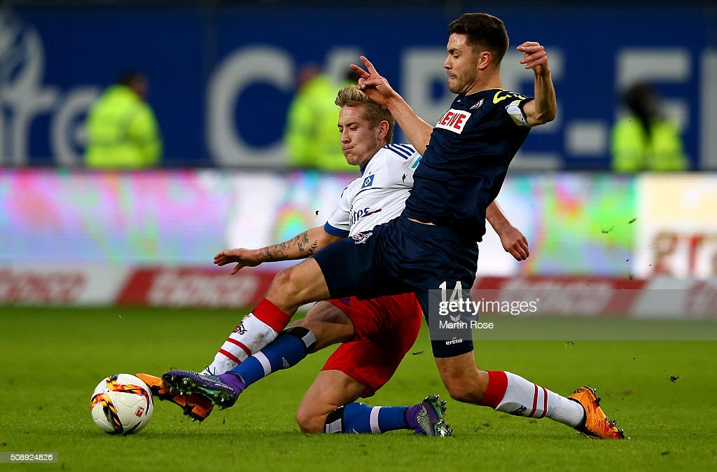 <a gi-track='captionPersonalityLinkClicked' href=/galleries/search?phrase=Lewis+Holtby&family=editorial&specificpeople=5351202 ng-click='$event.stopPropagation()'>Lewis Holtby</a> of Hamburg and <a gi-track='captionPersonalityLinkClicked' href=/galleries/search?phrase=Jonas+Hector&family=editorial&specificpeople=8121522 ng-click='$event.stopPropagation()'>Jonas Hector</a> #14 of Koeln battle for the ball during the Bundesliga match between Hamburger SV and 1. FC Koeln at Volksparkstadion on February 7, 2016 in Hamburg, Germany.