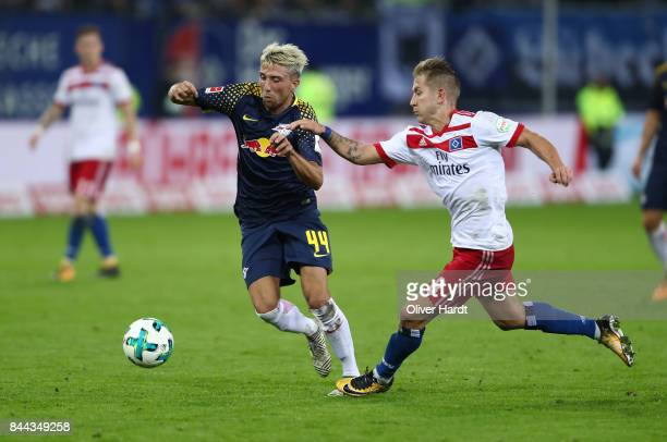 Lewis Holtby of Hamburg and Kevin Kampl of Leipzig compete for the ball during the Bundesliga match between Hamburger SV and RB Leipzig at...