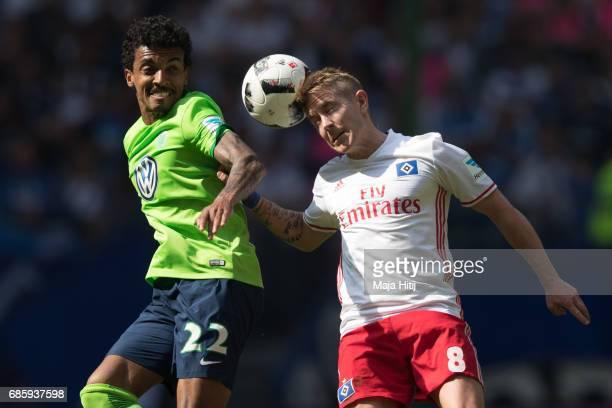 Lewis Holtby of Hamburg and Luiz Gustavo of Wolfsburg battle for the ball during the Bundesliga match between Hamburger SV and VfL Wolfsburg at...