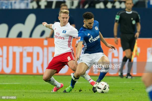 Lewis Holtby of Hamburg and Nabil Bentaleb of Schalke battle for the ball during to the Bundesliga match between FC Schalke 04 and Hamburger SV at...