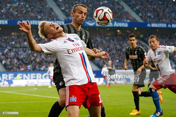Lewis Holtby of Hamburg and Pavel Krmas of Freiburg compete for the ball during the First Bundesliga match between Hamburger SV and SC Freiburg at...