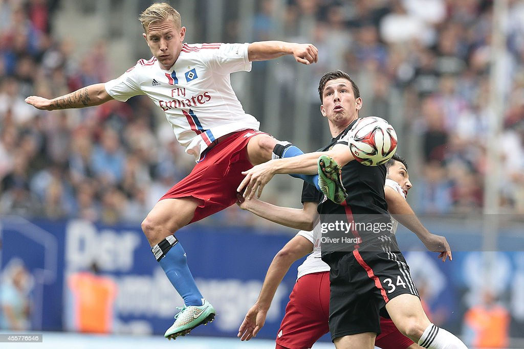 <a gi-track='captionPersonalityLinkClicked' href=/galleries/search?phrase=Lewis+Holtby&family=editorial&specificpeople=5351202 ng-click='$event.stopPropagation()'>Lewis Holtby</a> (L) of Hamburg and Pierre Emile Hojbjerg (R) of Munich compete for the ball during the Bundesliga match between Hamburger SV and FC Bayern Muenchen at Imtech Arena on September 20, 2014 in Hamburg, Germany.