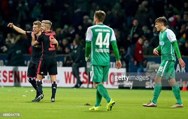 Lewis Holtby of Hamburg and team mate Sven Schipplock celebrate victory after the Bundesliga match between SV Werder Bremen and Hamburger SV at...