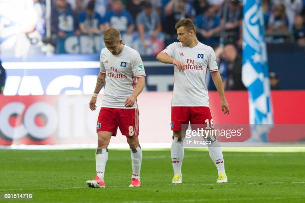 Lewis Holtby of Hamburg and Vasilije Janjicic of Hamburg looks dejected during to the Bundesliga match between FC Schalke 04 and Hamburger SV at...