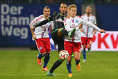 Lewis Holtby of Hamburg battles for the ball with Alejandro Galvez of Bremen during the Bundesliga match between Hamburger SV and SV Werder Bremen at...