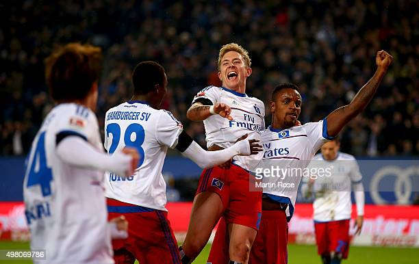 Lewis Holtby of Hamburg celebrate with his tem mates the 3rd goal during the Bundesliga match between Hamburger SV and Borussia Dortmund at...