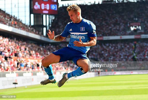 Lewis Holtby of Hamburg celebrates after he scores the opening goal during the Bundesliga match between 1 FC Koeln and Hamburger SV at...
