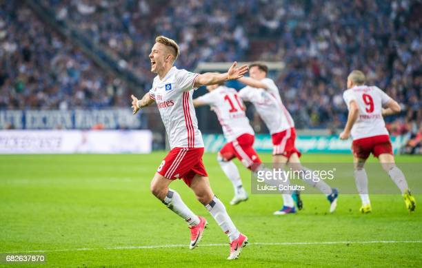 Lewis Holtby of Hamburg celebrates the teams first goal by PierreMichel Lasogga during the Bundesliga match between FC Schalke 04 and Hamburger SV at...