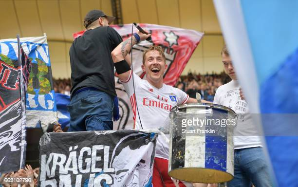 Lewis Holtby of Hamburg celebrates with fans after the Bundesliga match between Hamburger SV and 1 FC Koeln at Volksparkstadion on April 1 2017 in...