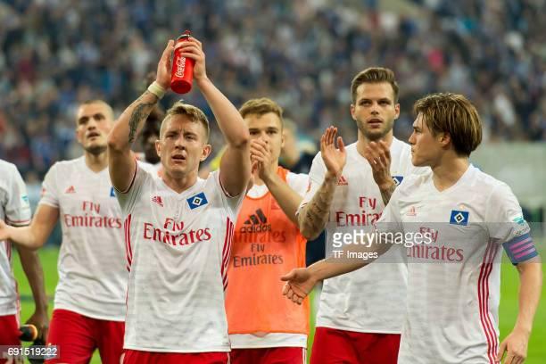 Lewis Holtby of Hamburg Dennis Diekmeier of Hamburg and Gotoku Sakai of Hamburg looks on during to the Bundesliga match between FC Schalke 04 and...