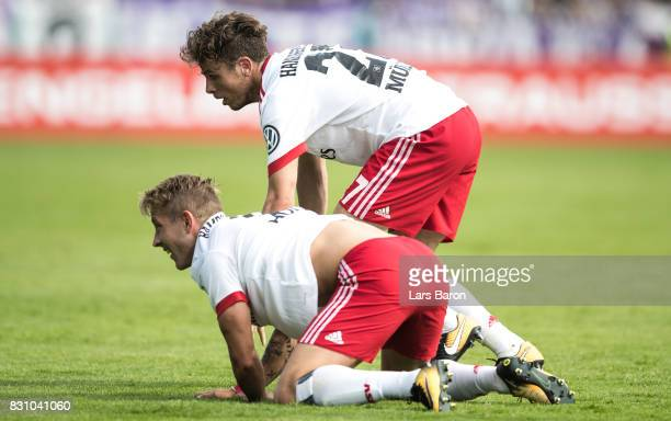 Lewis Holtby of Hamburg falls over Nicolai Mueller of Hamburg during the DFB Cup match between VfL Osnabrueck and Hamburger SV at Osnatel Arena on...