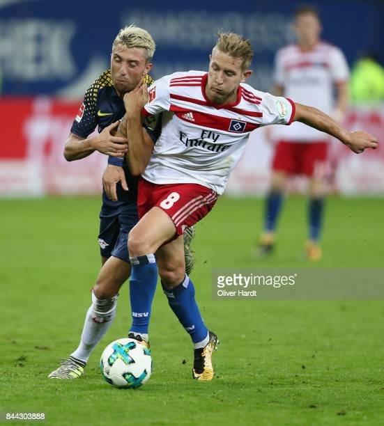 Lewis Holtby of Hamburg is challenged by Kevin Kampl of Leipzig during the Bundesliga match between Hamburger SV and RB Leipzig at Volksparkstadion...