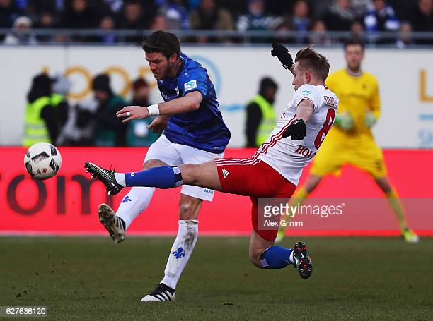 Lewis Holtby of Hamburg is challenged by Peter Niemeyer of Darmstadt during the Bundesliga match between SV Darmstadt 98 and Hamburger SV at Stadion...