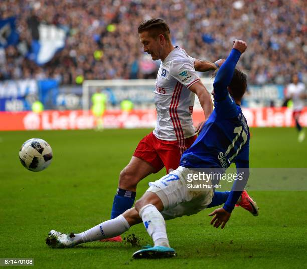 Lewis Holtby of Hamburg is challenged by Sandro Sirigu of Darmstadt during the Bundesliga match between Hamburger SV and SV Darmstadt 98 at...