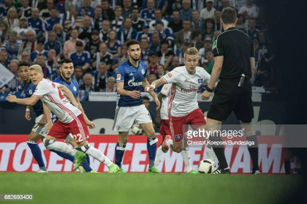 Lewis Holtby of Hamburg runs with the ball during the Bundesliga match between FC Schalke 04 and Hamburger SV at VeltinsArena on May 13 2017 in...