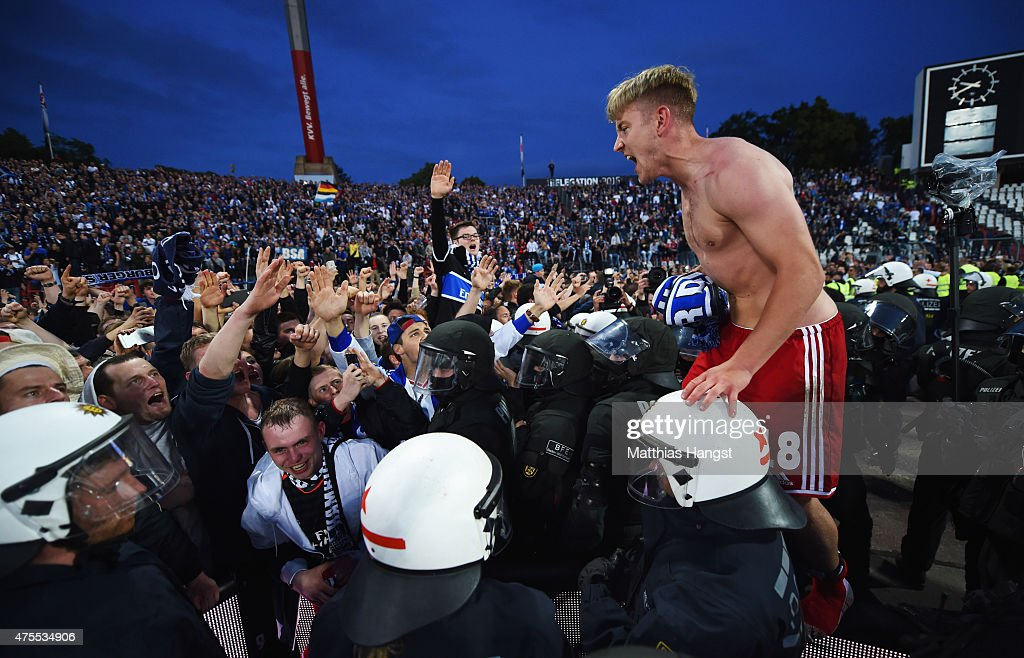 Lewis Holtby of Hamburger SV celebrates victory with fans after the Bundesliga playoff second leg match between Karlsruher SC and Hamburger SV on...