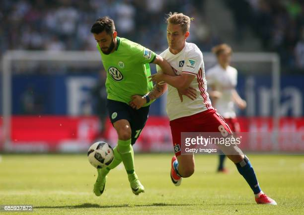 Lewis Holtby of HSV fights for the ball with Yunus Malli of Wolfsburg during the Bundesliga match between Hamburger SV and VfL Wolfsburg at...