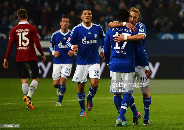 Lewis Holtby of Schalke celebrates after scoring his teams fifth goal during the Bundesliga match between FC Schalke 04 and Hannover 96 at...