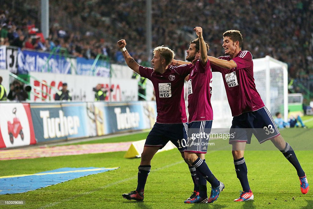 <a gi-track='captionPersonalityLinkClicked' href=/galleries/search?phrase=Lewis+Holtby&family=editorial&specificpeople=5351202 ng-click='$event.stopPropagation()'>Lewis Holtby</a> of Schalke celebrates his team's second goal with team mates <a gi-track='captionPersonalityLinkClicked' href=/galleries/search?phrase=Tranquillo+Barnetta&family=editorial&specificpeople=534444 ng-click='$event.stopPropagation()'>Tranquillo Barnetta</a> and Roman Neustaedter (L-R) during the Bundesliga match between SpVgg Greuther Fuerth and FC Schalke 04 at Trolli-Arena on September 15, 2012 in Fuerth, Germany.