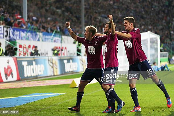 Lewis Holtby of Schalke celebrates his team's second goal with team mates Tranquillo Barnetta and Roman Neustaedter during the Bundesliga match...