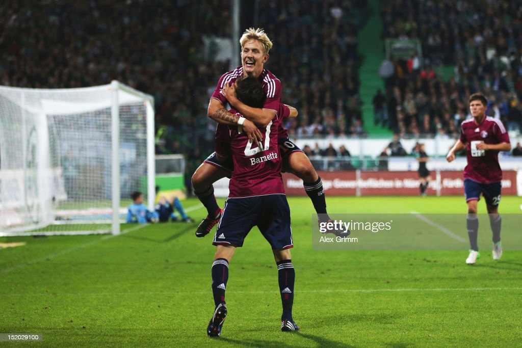 Lewis Holtby of Schalke celebrates his team's second goal with team mate Tranquillo Barnetta during the Bundesliga match between SpVgg Greuther Fuerth and FC Schalke 04 at Trolli-Arena on September 15, 2012 in Fuerth, Germany.