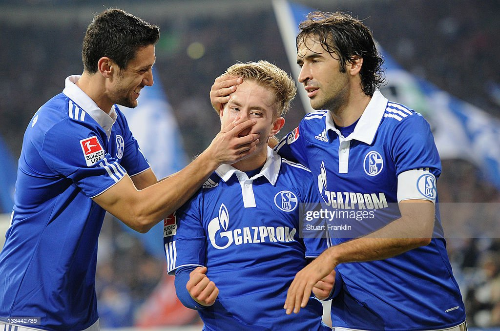 Lewis Holtby of Schalke celebrates scoring the fourth goal with Ciprian Marica and Raul Gonzales during the Bundesliga match between FC Schalke 04...