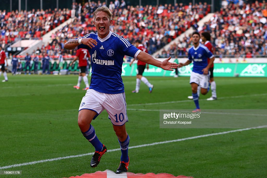 <a gi-track='captionPersonalityLinkClicked' href=/galleries/search?phrase=Lewis+Holtby&family=editorial&specificpeople=5351202 ng-click='$event.stopPropagation()'>Lewis Holtby</a> of Schalke celebrates the second goal during the Bundesliga match between Hannover 96 and FC Schalke 04 at AWD Arena on August 26, 2012 in Hannover, Germany.