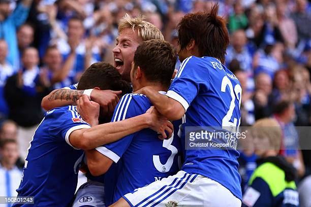 Lewis Holtby of Schalke celebrates the second goal with KlaasJan Huntelaar Roman Neustaedter and Atsuto Uchida of Schalke during the Bundesliga match...
