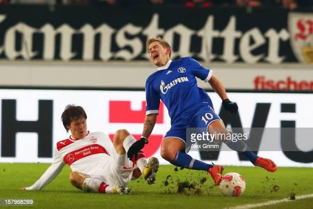 Lewis Holtby of Schalke is challenged by Gotoku Sakai of Stuttgart during the Bundesliga match between VfB Stuttgart and FC Schalke 04 at...
