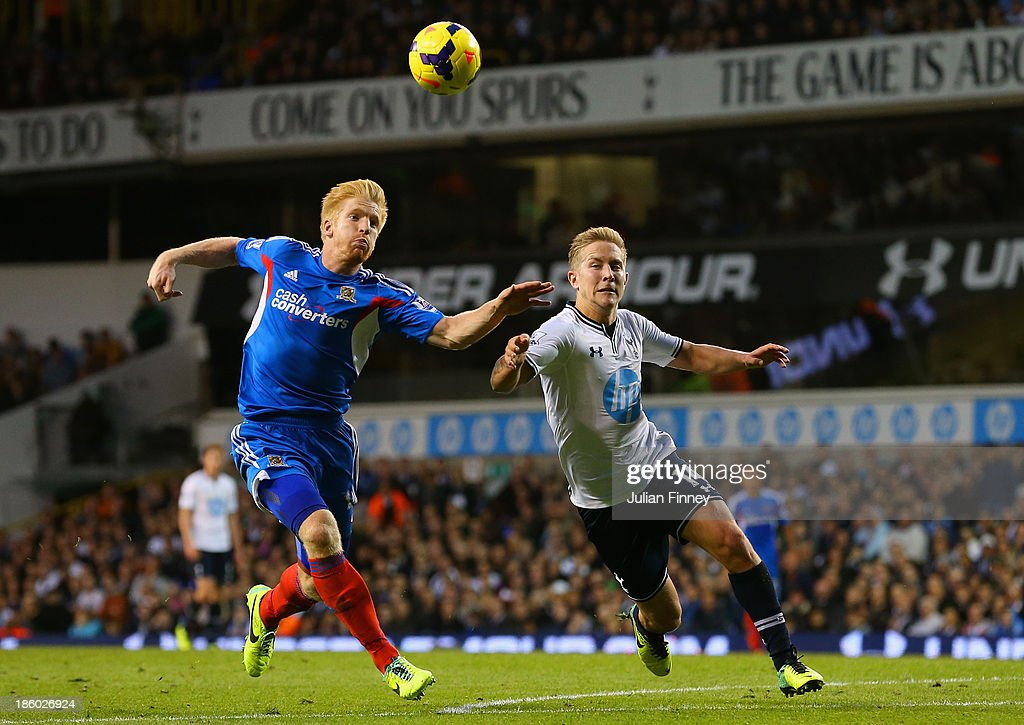 Lewis Holtby of Spurs clashes with Paul McShane of Hull City during the Barclays Premier League match between Tottenham Hotspur and Hull City at White Hart Lane on October 27, 2013 in London, England.