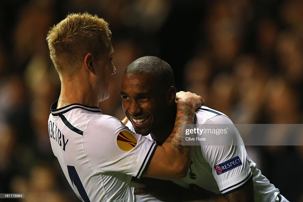 <a gi-track='captionPersonalityLinkClicked' href=/galleries/search?phrase=Lewis+Holtby&family=editorial&specificpeople=5351202 ng-click='$event.stopPropagation()'>Lewis Holtby</a> of Spurs congratulates <a gi-track='captionPersonalityLinkClicked' href=/galleries/search?phrase=Jermain+Defoe&family=editorial&specificpeople=171106 ng-click='$event.stopPropagation()'>Jermain Defoe</a> of Spurs on scoring his second goal during the UEFA Europa League Group K match between Tottenham Hotspur FC and Tromso IL at White Hart Lane on September 19, 2013 in London, England.