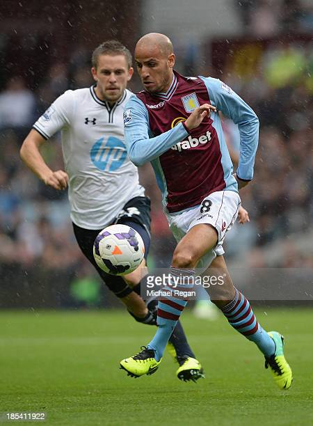 Lewis Holtby of Spurs marshalls Karim El Ahmadi of Aston Villa during the Barclays Premier League match between Aston Villa and Tottenham Hotspur at...
